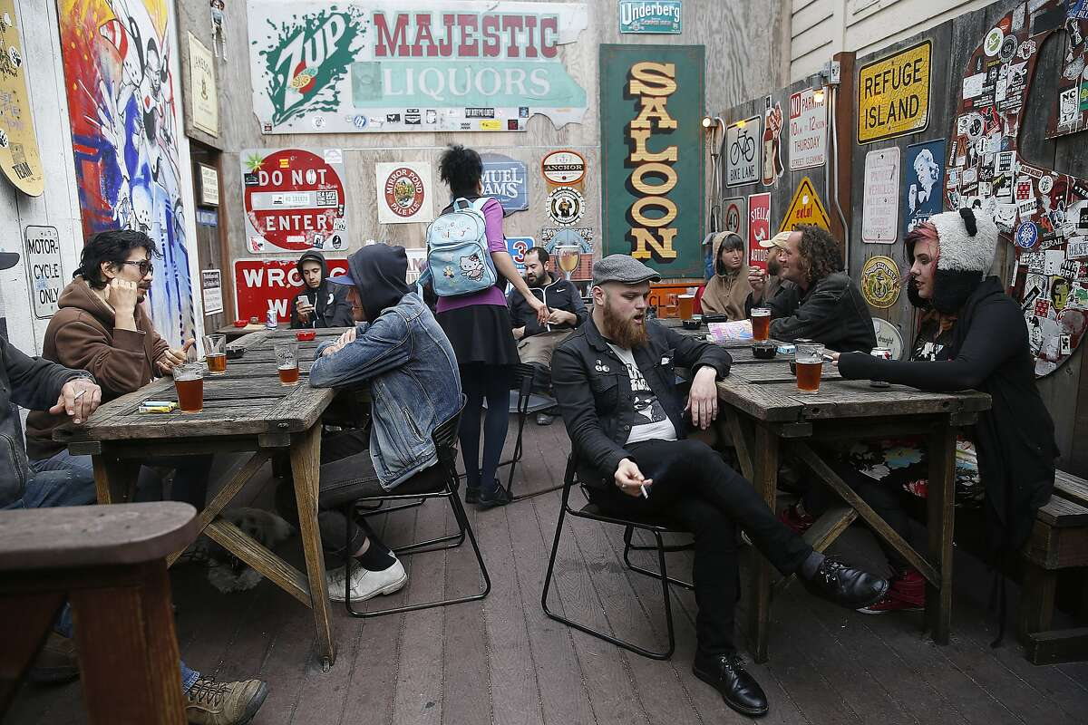 Don Johnson (middle front) from San Francisco and Meah Night (right) from Oakland are not vegan but Johnson likes seitan and Meah eats vegan food as long as it's tasty at Bender's Bar and Grill in San Francisco, California, on Tuesday, June 2, 2015. They wait for their order.