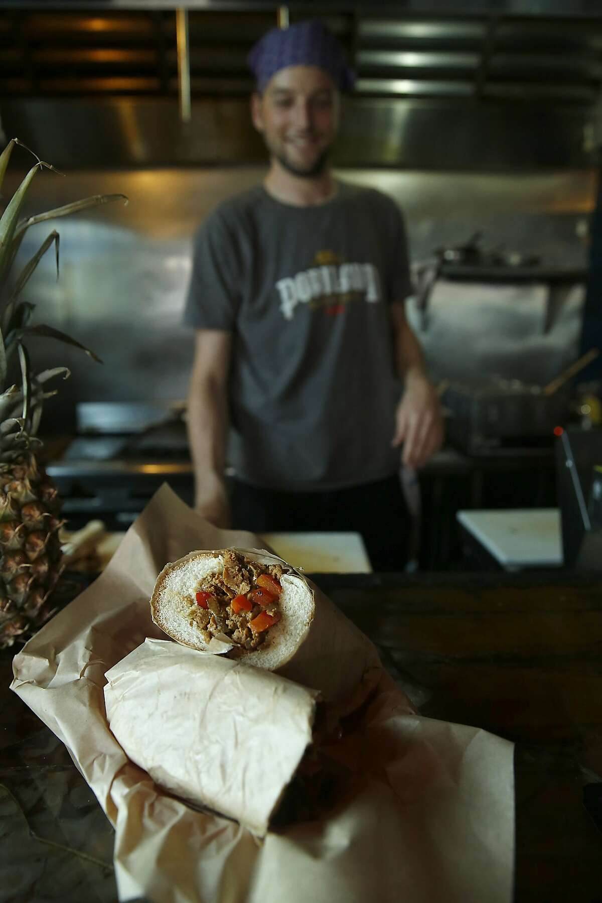 General manager and head chef Robby Harden (left) makes a Satan's Philly Cheese at Bender's Bar and Grill in San Francisco, California, on Tuesday, June 2, 2015.