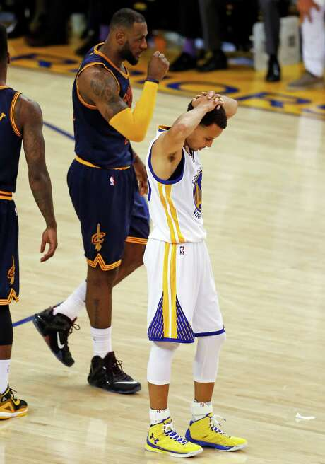 Golden State Warriors' Stephen Curry reacts as Cleveland Cavaliers' LeBron James walks past during Cavaliers' 95-93 overtime win in Game 2 of the 2015 NBA Finals at Oracle Arena in Oakland, Calif., on Sunday, June 7, 2015. Photo: Scott Strazzante / The Chronicle / ONLINE_YES