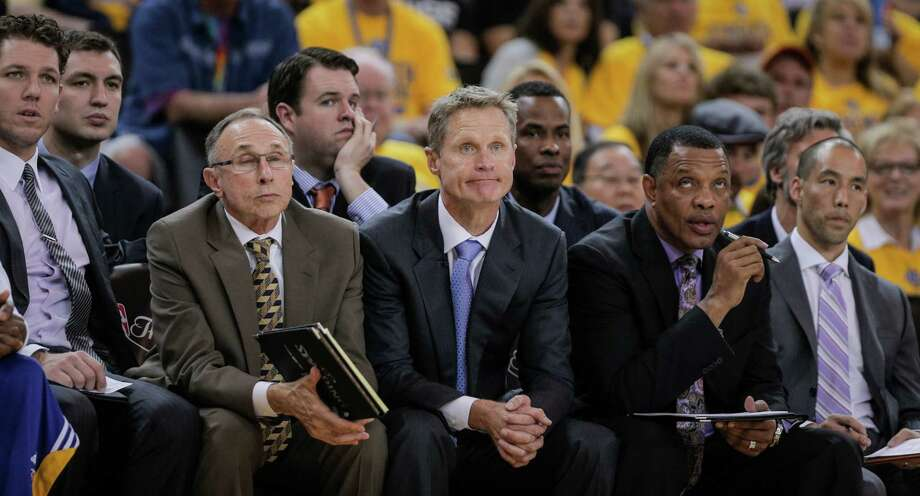 Golden State Warriors' Coach Steve Kerr and his staff watch the third period during Game 2 of The NBA Finals on Sunday, June 7, 2015 in Oakland, Calif. Photo: Carlos Avila Gonzalez / The Chronicle / ONLINE_YES