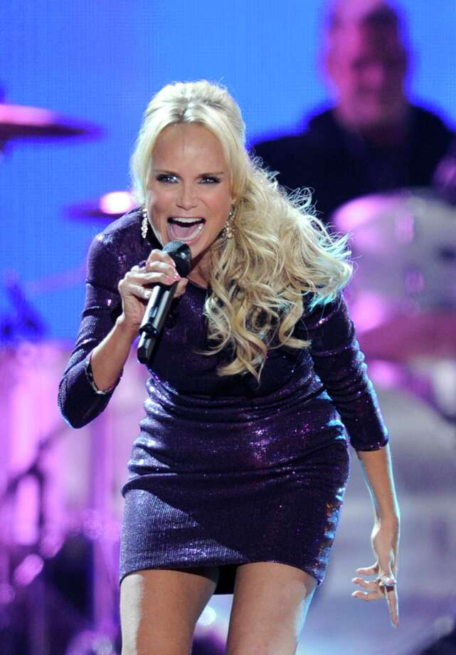Co-Host Kristin Chenoweth speaks onstage at the American Country Awards 2011 at the MGM Grand Garden Arena on December 5, 2011 in Las Vegas, Nevada. (Photo by Ethan Miller/Getty Images)  LAS VEGAS, NV - DECEMBER 05:  Co-Host Kristin Chenoweth speaks onstage at the American Country Awards 2011 at the MGM Grand Garden Arena on December 5, 2011 in Las Vegas, Nevada.  (Photo by Ethan Miller/Getty Images) Photo: Ethan Miller, Staff / 2011 Getty Images