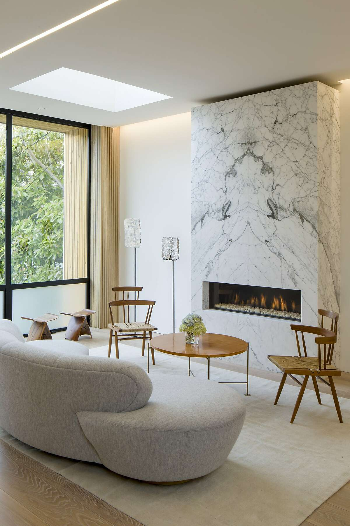Marble, frosted glass, vertical windows and a skylight incorporate natural light into this Cow Hollow living room.