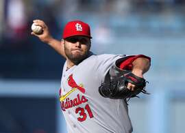 St. Louis Cardinals starting pitcher Lance Lynn throws to the plate during the first inning of a baseball game against the Los Angeles Dodgers, Sunday, June 7, 2015, in Los Angeles. (AP Photo/Mark J. Terrill)