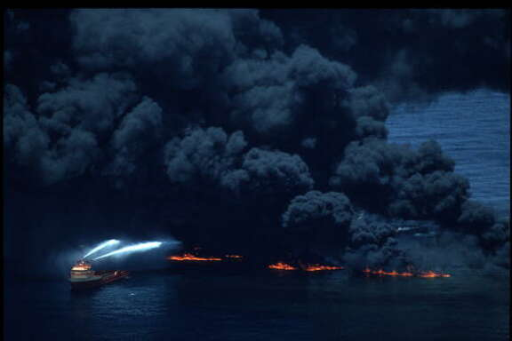 73033 01: The coast guard attempts to smother the blaze with foam June 11, 1990 in the Gulf of Mexico. The supertanker began burning crude oil after explosions occurred while cargo was transfered to a smaller tanker. (Photo by Paul Howell/Liaison)