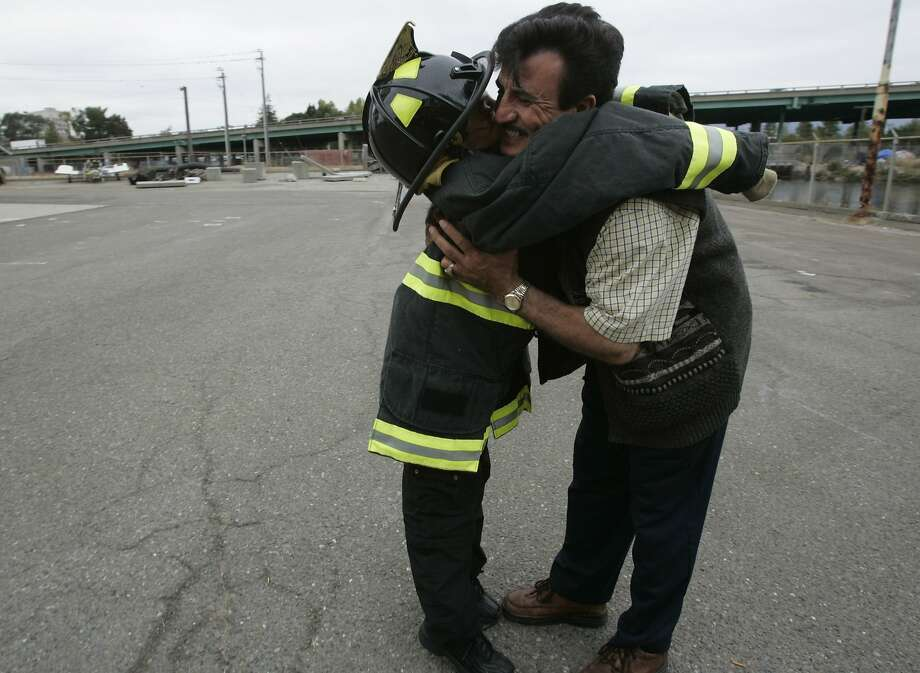Saleh Khalef, then 10, is honored by the Oakland Fire Department in 2004. Photo: Deanne Fitzmaurice, SFC