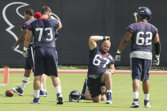 Houston Texans offensive linemen Matt Feiler (73), Cody White (67) and Chad Slade (62) get ready for practice during Texans' organized team activities at the Methodist Training Center Monday, June 8, 2015, in Houston.  ( Brett Coomer / Houston Chronicle )