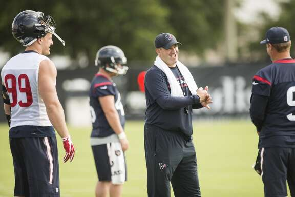 Houston Texans head coach Bill O'Brien, center, talks to defensive end J.J. Watt (99) and punter Shane Lechler (9) during Texans' organized team activities at the Methodist Training Center Monday, June 8, 2015, in Houston.  ( Brett Coomer / Houston Chronicle )