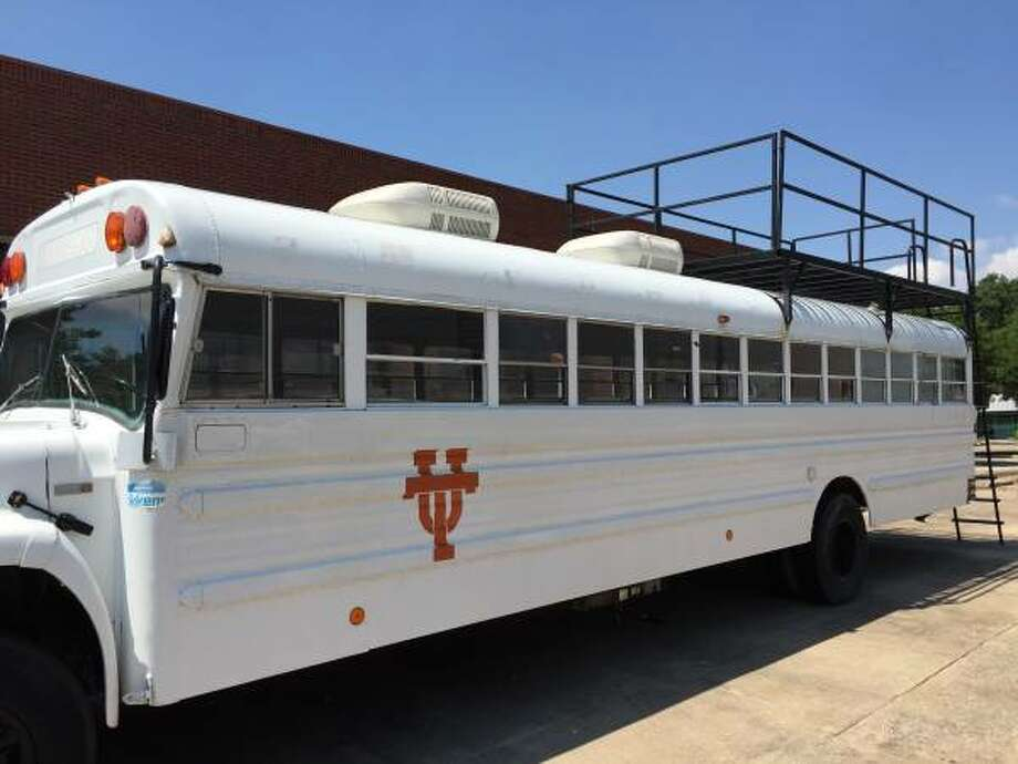This specialty University of Texas Longhorn fan bus is for sale for $10,000. It includes indoor and outdoor beer taps, sleeping space for 5, a toilet, ceiling mounted air conditioning and wiring for an interior TV and sound system. Photo: Andrew Stocker