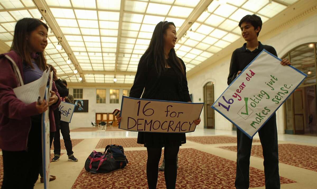 (From left) Anna He, 16, Jillian Wu, 16, and Oliver York, 16 chat before participating in a rally held by the San Francisco Youth Commission at City Hall in San Francisco, Calif. Monday, March 16, 2015 to shine light on new legislation to allow 16 and 17-year-olds to vote in San Francisco.