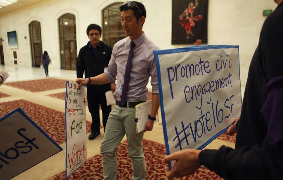 Allen Lu, an S.F. Youth Commission employee, prepares for a rally in March on youth voting. Photo: Jessica Christian, The Chronicle