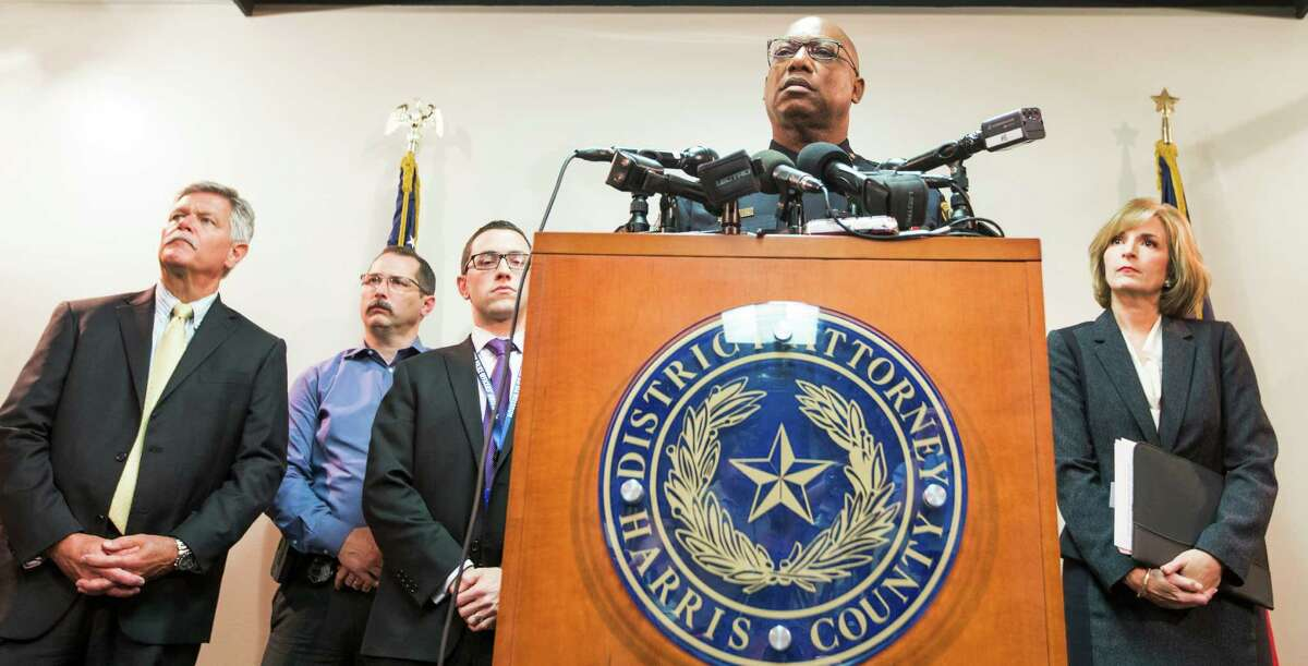 Houston Police Chief Charles McClelland, with Harris County District Attorney Devon Anderson, right, speaks during a news conference announcing that the conviction of Alfred Dewayne Brown was thrown out on Monday, June 8, 2015, in Houston. Brown's conviction and death sentence, involving the 2003 fatal shooting of Houston Police officer Charles Clark and store clerk Alfredia Jones, was reversed, based on evidence being withheld by prosecutors.