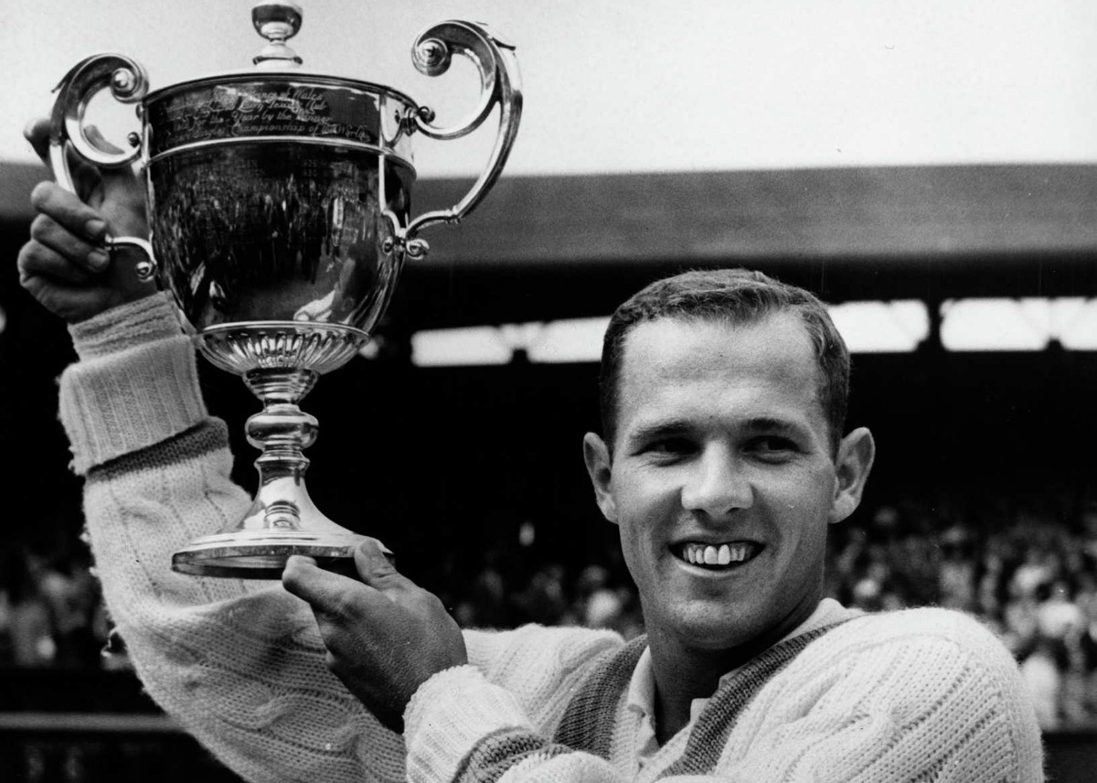Chuck McKinley holds the trophy he won for beating Fred Stolle of Australia in the men's singles finals at Wimbledon on July 5, 1963. He won, 9-7, 6-1, 6-4. McKinley was a tennis standout at Trinity University.