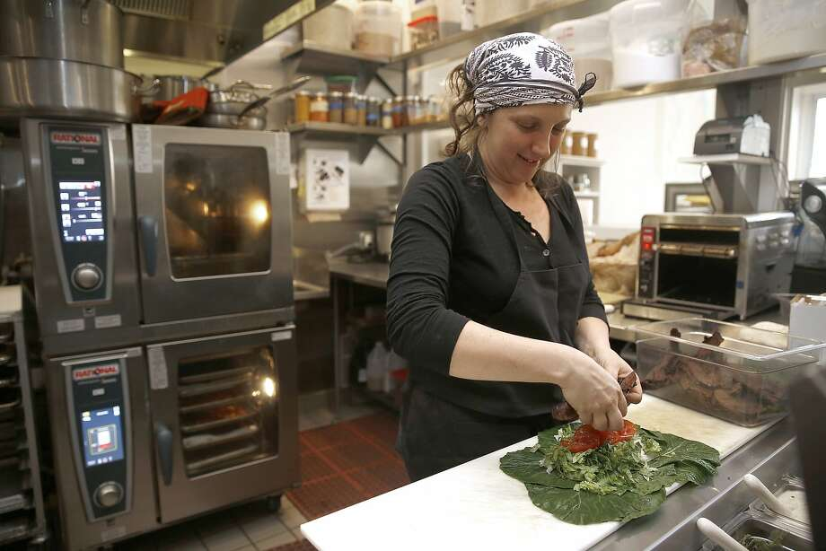 Executive chef Ariel Nadelberg makes a collard wrap at Seed + Salt in San Francisco. Photo: Liz Hafalia, The Chronicle