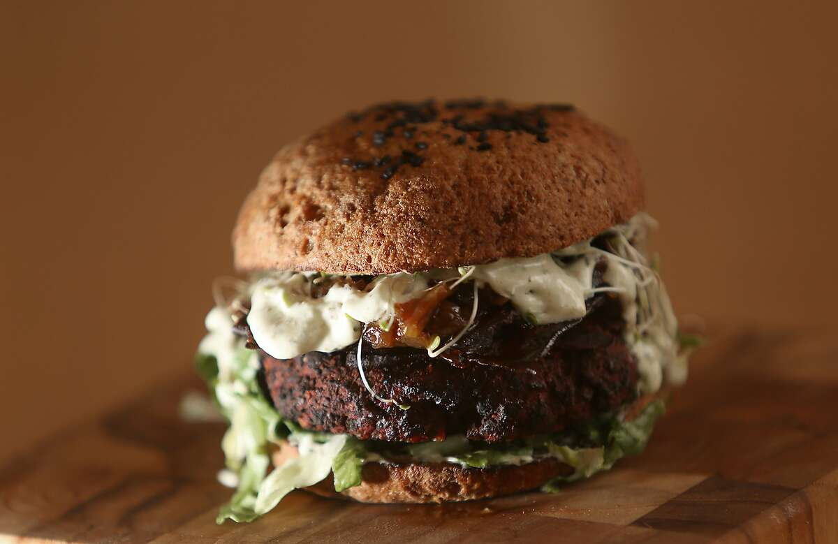 An S+S burger--beets, walnuts, lentils, mushrooms, brown rice, raisins, spices, smoked sea salt+ ranch served on a GF burger bun and S+S pickles--at Seed and Salt in San Francisco, California, on Tuesday, June 2, 2015.