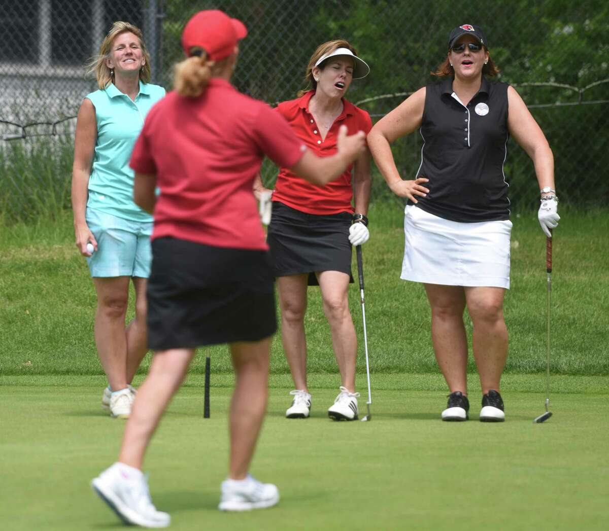 Greenwich women, from left, Patty Waurishuk, Renee Murphy, Maureen Sheehan and Laurie Meek react to a missed putt during the Greenwich High School football annual fundraiser golf tournament at E. Gaynor Brennan Golf Course in Stamford, Conn. Monday, June 8, 2015. Thirty foursomes, a total of 120 people, participated in this year's best-ball tournament to raise money for the Greenwich High School football program.