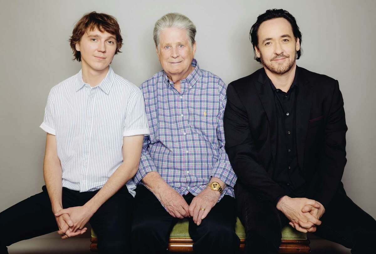 """Former Beach Boy Brian Wilson, center, is joined by the two actors who portray him in the movie """"Love & Mercy"""" - Paul Dano, left, and John Cusack."""