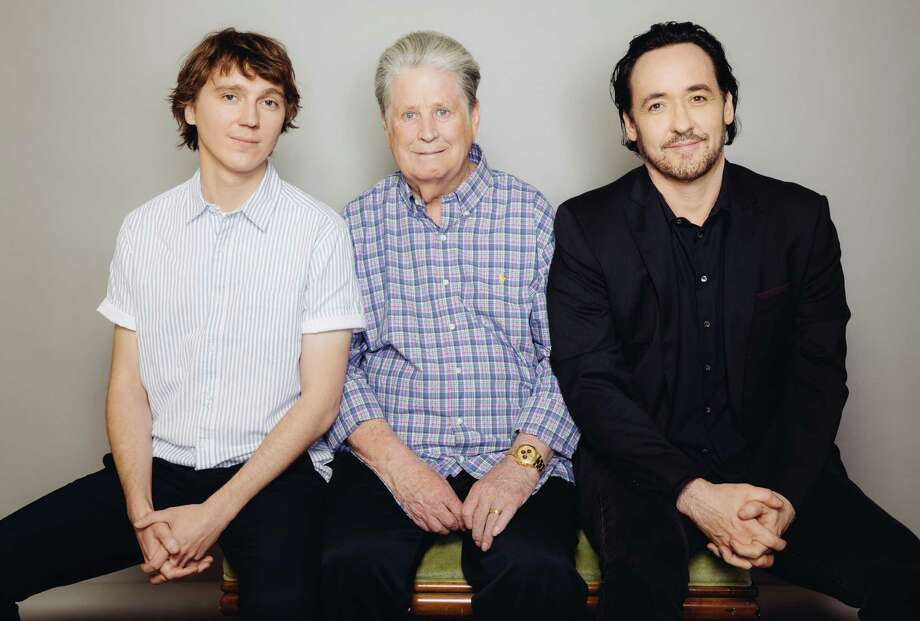 "Former Beach Boy Brian Wilson, center, is joined by the two actors who portray him in the movie ""Love & Mercy"" - Paul Dano, left, and John Cusack.  Photo: Casey Curry, INVL / Invision"
