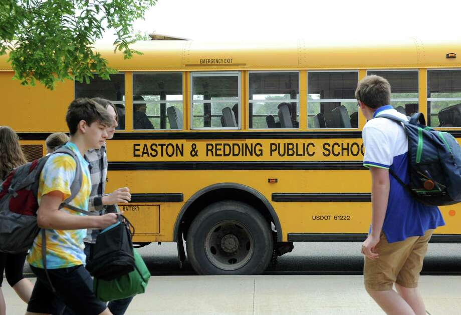 Students at Joel Barlow High School in Redding head for the buses at dismissal time Monday afternoon, June 8. Redding and Easton are considering switicing from diesel to natural gas buses. Photo: Carol Kaliff / Staff Photographer / The News-Times