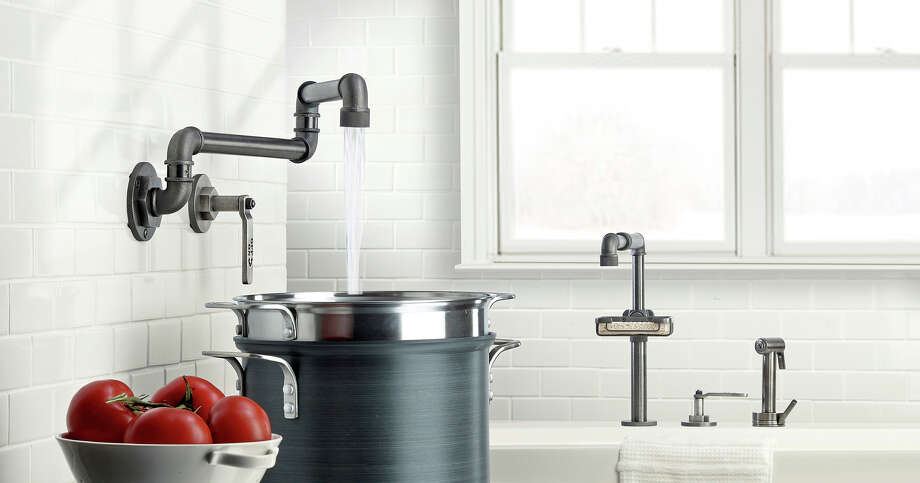 Inspired by industrial pipe fittings, the Elan Vital series features lever handles that are reminiscent of commercial ball valves; the pot filler and faucet are shown (from $1,200, watermark-designs.com). Photo: HANDOUT, STR / THE WASHINGTON POST