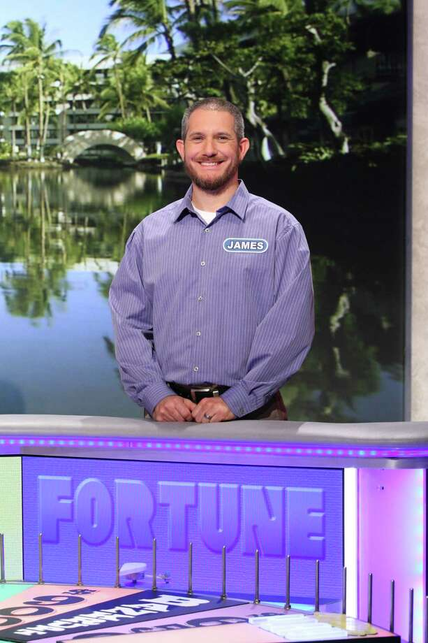 "Cypress resident James Ramey won $56,500 in cash and prizes during  Tuesday's  episode of ""Wheel of Fortune."" He says the wheel is heavier than it looks. Photo: Carol Kaelson / © 2015 Califon Productions, Inc."
