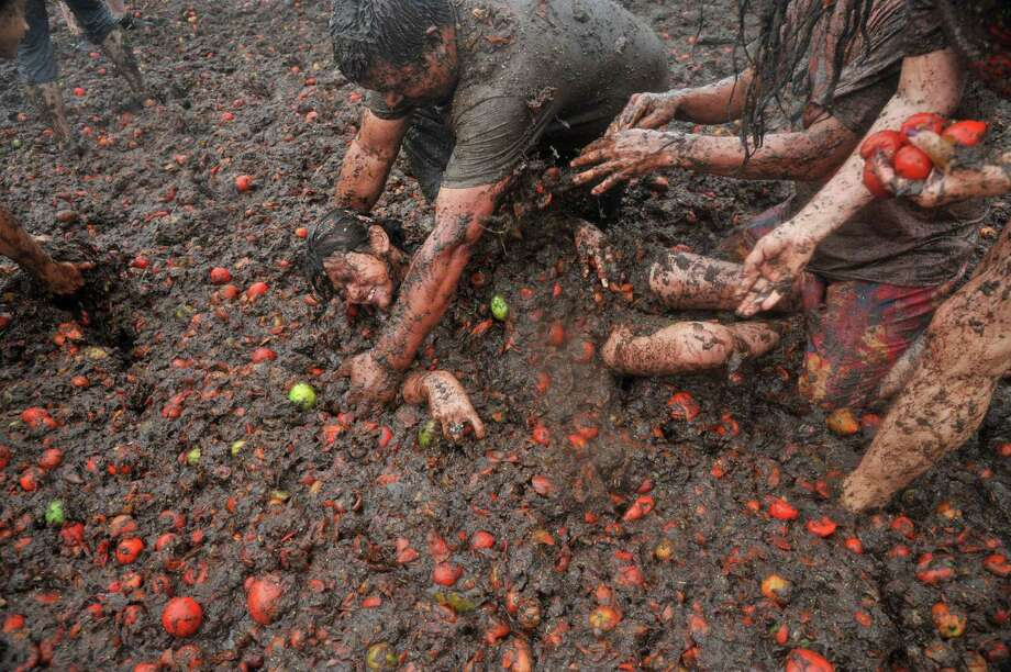 "People participate in the ninth annual tomato fight festival, known as ""tomatina"", in Sutamarchan, Boyaca department, Colombia, on June 7, 2015. Photo: GUILLERMO LEGARIA, AFP / Getty Images / GUILLERMO LEGARIA"