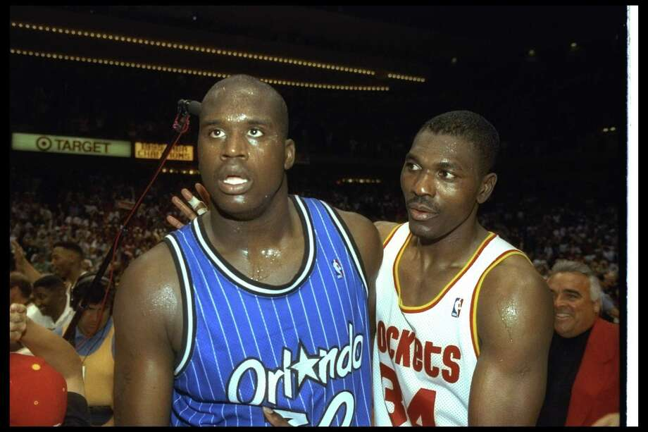 Center Shaquille O'Neal of the Orlando Magic (left) and Houston Rockets forward Hakeem Olajuwon walk off the floor after Game 4 of the 1995 NBA Finals at the Summit in Houston. The Rockets won the game, 113-101. Photo: Getty Images / Getty Images Sport Classic