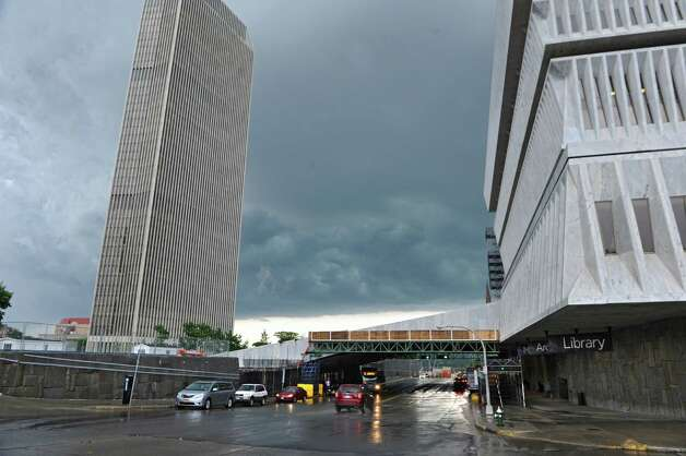 Dark storm clouds are seen beyond the Corning Tower and the New York State Museum on Monday, June 8, 2015 in Albany, N.Y. (Lori Van Buren / Times Union) Photo: Lori Van Buren