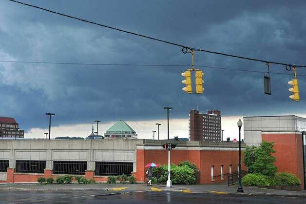 Dark storm clouds are seen over a parking garage on Monday, June 8, 2015 in Albany, N.Y. (Lori Van Buren / Times Union) Photo: Lori Van Buren