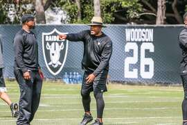 New Oakland Raiders defensive coordinator Ken Norton Jr. shouts out instructions during a team practice in Alameda.