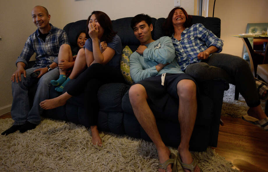 The Reyes family — Gennis (left), Ezekiel, Erika, Elijah and Maria — watch a video of Erika's graduation at home in Daly City. Photo: Brandon Chew / Brandon Chew / The Chronicle / ONLINE_YES