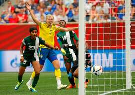 WINNIPEG, MB - JUNE 08:  Linda Sembrant #3 of Sweden reacts after scoring the third goal against goalkeeper Precious Dede #1 and Ngozi Ebere #23 of Nigeria during the FIFA Women's World Cup Canada 2015 Group D match between Sweden and Nigeria at Winnipeg Stadium on June 8, 2015 in Winnipeg, Canada.  (Photo by Kevin C. Cox/Getty Images)