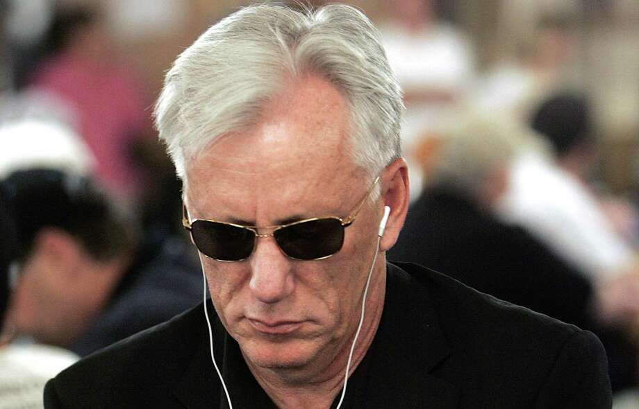 Actor James Woods checks his cards Saturday, July, 9, 2005 in the World Series of Poker at the Rio Hotel and Casino in Las Vegas. Photo: Associated Press File Photo / AP