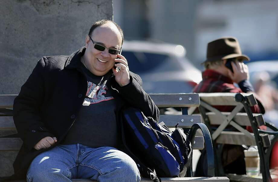 John DeCarli of San Francisco talks on his cell phone as he rests at the Ferry Building,  Tuesday Feb. 22, 2011, in San Francisco, Calif. A new study published in JAMA shows that cell phones do in fact have an affect on brain activity, but it's unclear if it's a dangerous effect or not. Photo: Lacy Atkins, The Chronicle