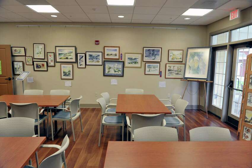 A view of the activities room with artwork from resident, Robert Louis Trudeau, on display at the Shaker Pointe at Carondelet, an independent living community on Monday, June 8, 2015, in Watervliet, N.Y. In late May, 56 new units were finished which brings the total number of units from phase one and phase two to 162. (Paul Buckowski / Times Union)