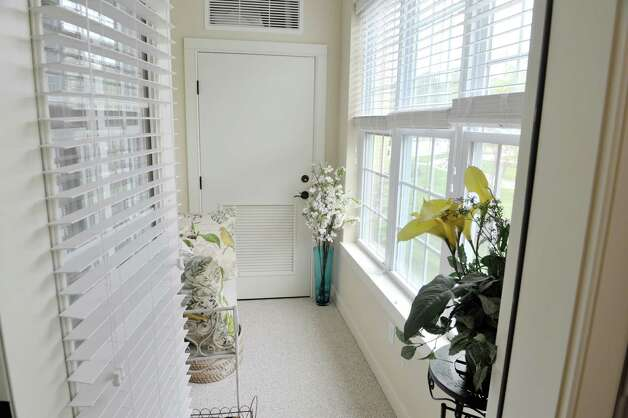 A view of the porch area inside one of the units at the Shaker Pointe at Carondelet, an independent living community on Monday, June 8, 2015, in Watervliet, N.Y. This unit is a one bedroom with a den. Units come as a one bedroom, a one bedroom with a den or a two bedroom. In late May, 56 new units were finished which brings the total number of units from phase one and phase two to 162.     (Paul Buckowski / Times Union) Photo: PAUL BUCKOWSKI / 00032130A