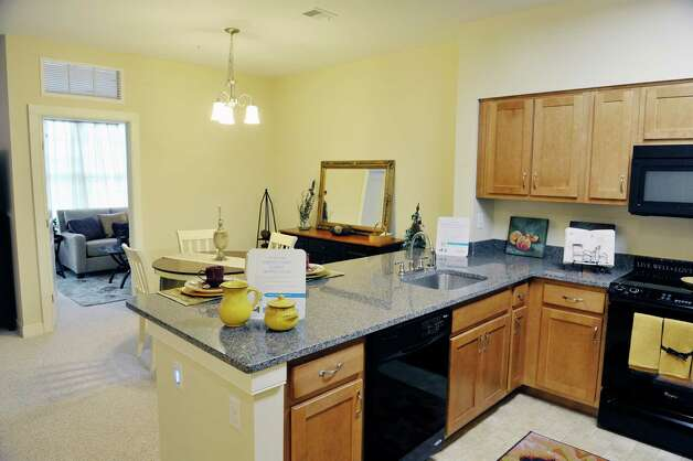 A view of the kitchen and dining room inside one of the units at the Shaker Pointe at Carondelet, an independent living community on Monday, June 8, 2015, in Watervliet, N.Y. This unit is a one bedroom with a den. Units come as a one bedroom, a one bedroom with a den or a two bedroom. In late May, 56 new units were finished which brings the total number of units from phase one and phase two to 162.     (Paul Buckowski / Times Union) Photo: PAUL BUCKOWSKI / 00032130A