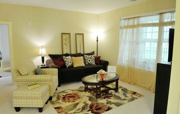 A view of the living room inside one of the units at the Shaker Pointe at Carondelet, an independent living community on Monday, June 8, 2015, in Watervliet, N.Y. This unit is a one bedroom with a den. Units come as a one bedroom, a one bedroom with a den or a two bedroom. In late May, 56 new units were finished which brings the total number of units from phase one and phase two to 162.     (Paul Buckowski / Times Union) Photo: PAUL BUCKOWSKI / 00032130A