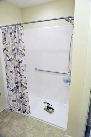 A view of the bathroom with a shower that allows a wheelchair to roll in, inside one of the units at the Shaker Pointe at Carondelet, an independent living community on Monday, June 8, 2015, in Watervliet, N.Y.  All the units have this type of shower.  This unit is a one bedroom with a den. Units come as a one bedroom, a one bedroom with a den or a two bedroom. In late May, 56 new units were finished which brings the total number of units from phase one and phase two to 162.     (Paul Buckowski / Times Union) Photo: PAUL BUCKOWSKI / 00032130A