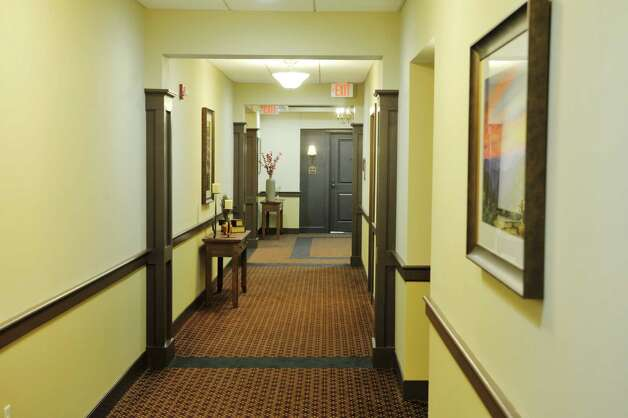A view looking down the hallway at the Shaker Pointe at Carondelet, an independent living community on Monday, June 8, 2015, in Watervliet, N.Y. Units come as a one bedroom, a one bedroom with a den or a two bedroom. In late May, 56 new units were finished which brings the total number of units from phase one and phase two to 162.     (Paul Buckowski / Times Union) Photo: PAUL BUCKOWSKI / 00032130A