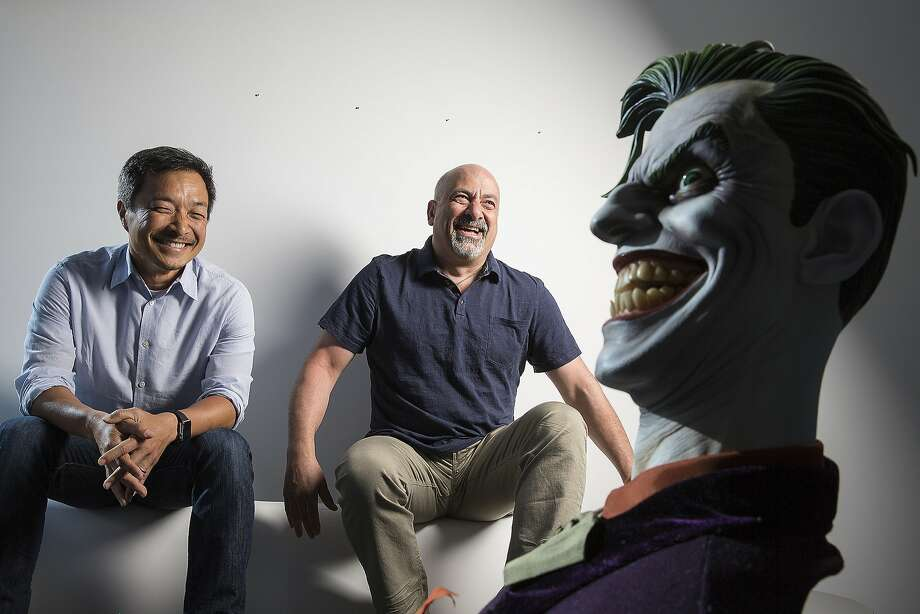 DC Comics publishers Jim Lee (left) and Dan DiDio join comic figures at the company's headquarters in Burbank. With the new location, close to parent company Warner Bros. Studios, comes a new vision with projects designed to expand the audience. Photo: Robert Gauthier, McClatchy-Tribune News Service