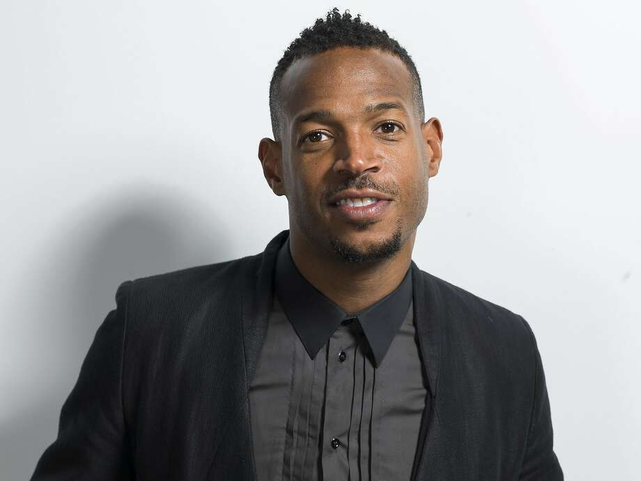 """American actor and star in the NBC network comedy series """"I Can Do That"""" Marlon Wayans poses for a portrait on Thursday, June 4, 2015, in New York. What do you get when you take one of the year's biggest box office hits - """"Fifty Shades of Grey"""" - and turn it over to funny man Wayans? Christian Grey is turning into Christian Black in Wayans' spoof of the film """"Fifty Shades of Black,"""" which has been picked up by Open Road Films for release next January. (Photo by Scott Gries/Invision/AP) Photo: Scott Gries, Associated Press"""