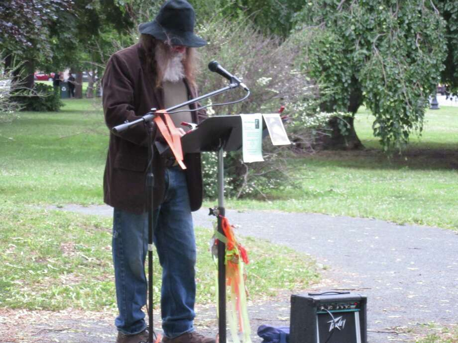 """Is that ... Walt Whitman? Well, it?s not, but the words from Fred Pfeiffer?s lips are indeed those of the poet's, as he recites """"Song of Myself"""" at the Robert Burns Statue in Albany's Washington Park on May 31, which was Whitman?s birthday. (Dan Wilcox)"""
