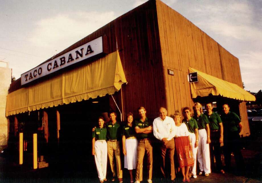 Taco Cabana founders Felix and Billie Jo Stehling with their employees in front of the first restaurant on the corner of San Pedro Avenue and Hildebrand Avenue. Photo: Courtesy Photo /Taco Cabana