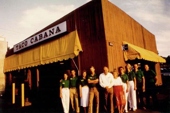 Taco Cabana founders Felix and Billie Jo Stehling with their employees in front of the first restaurant on the corner of San Pedro Avenue and Hildebrand Avenue.