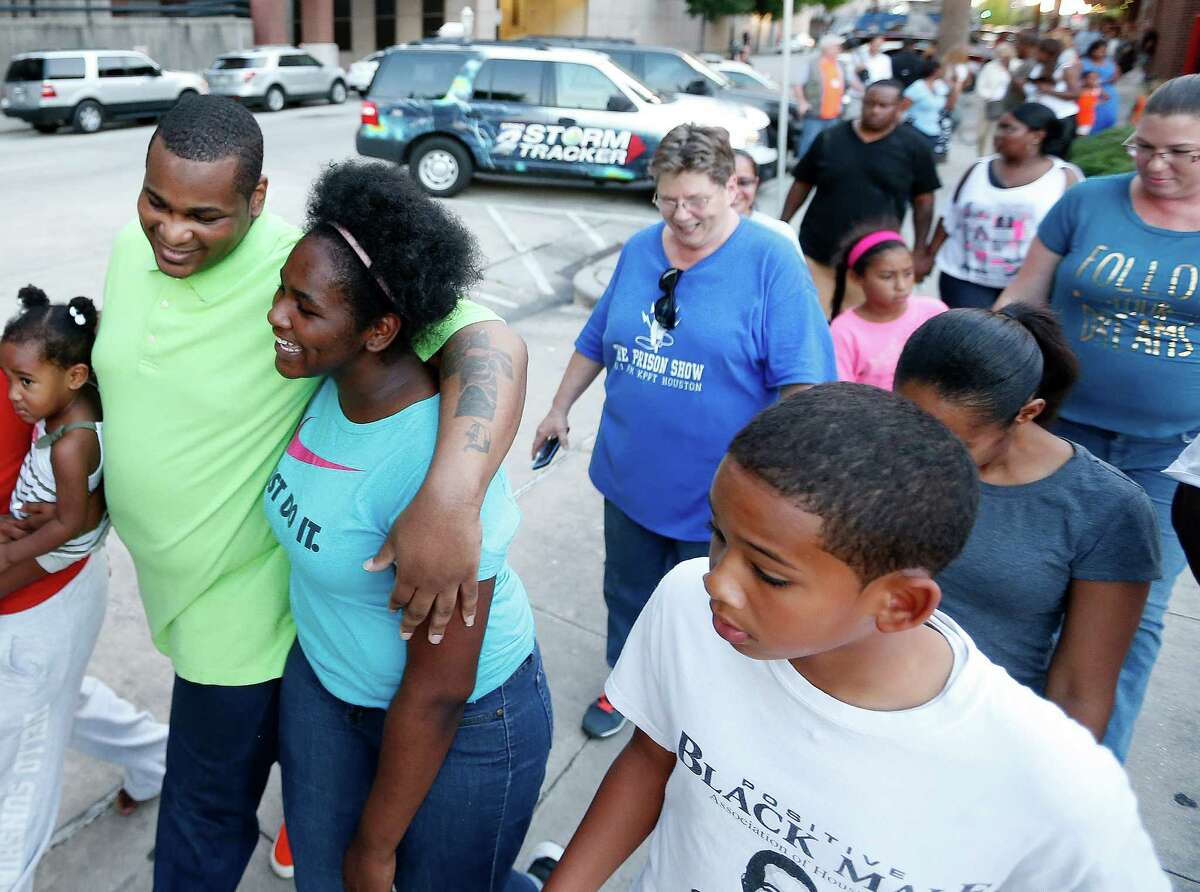 Alfred Brown walks out of the Harris County Jail with his daughter Kierra Brown, 15, right on Monday, June 8, 2015, in Houston.