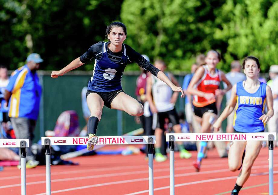 Olivia Wiener from Staples runs in the 300m hurdles at the State Open Track and Field Championships, on Monday Jun 6, 2015 at  Willowbrook Park in New Britain, Connecticut. Photo: Bill Shettle, For The / Connecticut Post Freelance