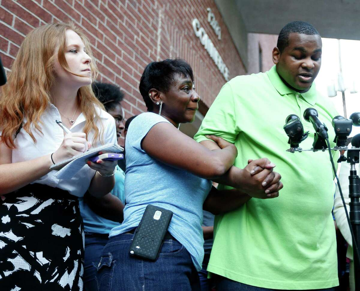 Houston Chronicle columnist, Lisa Falkenberg gets into position as Alfred Brown spoke to the media, with his sister Connie Brown, at his side after his release from the Harris County jail on Monday, June 8, 2015, in Houston.