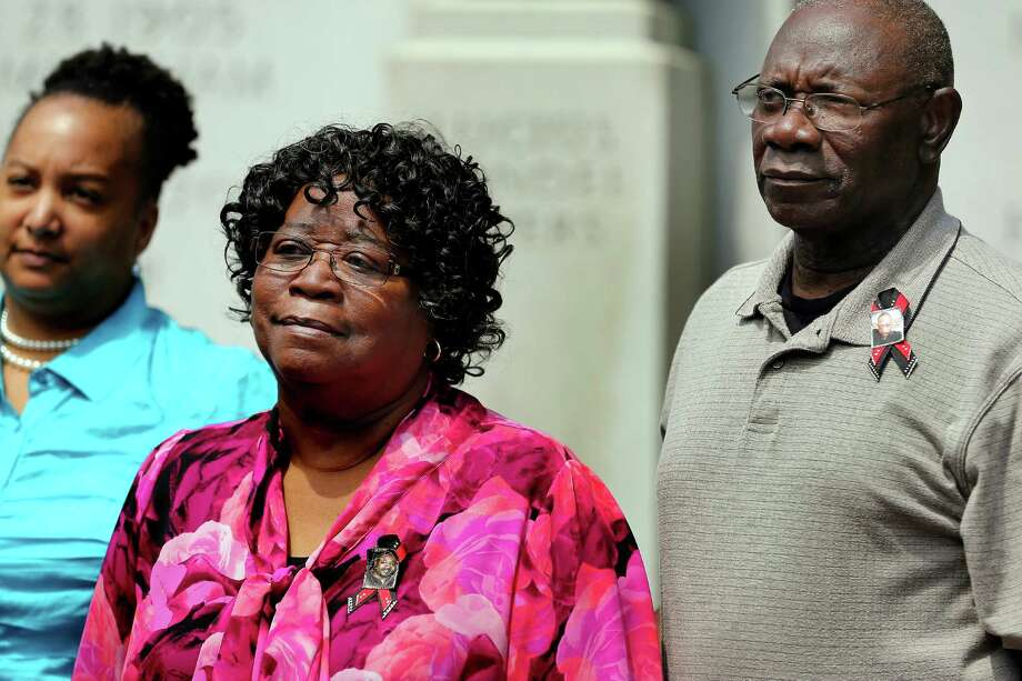 Walter Scott's parents, Judy Scott and Walter Scott Sr., gather with attorneys outside the Charleston County Courthouse after a grand jury handed down an indictment in Scott's death. Photo: Grace Beahm, MBI / The Post and Courier