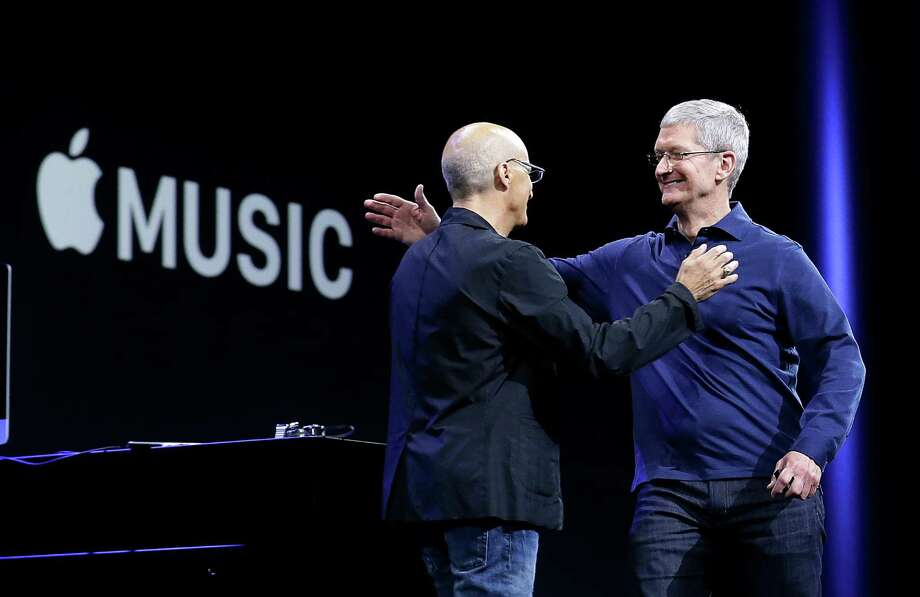 Apple CEO Tim Cook (right) is launching Apple Music, its new, paid streaming-music service.  Photo: Jeff Chiu, STF / AP