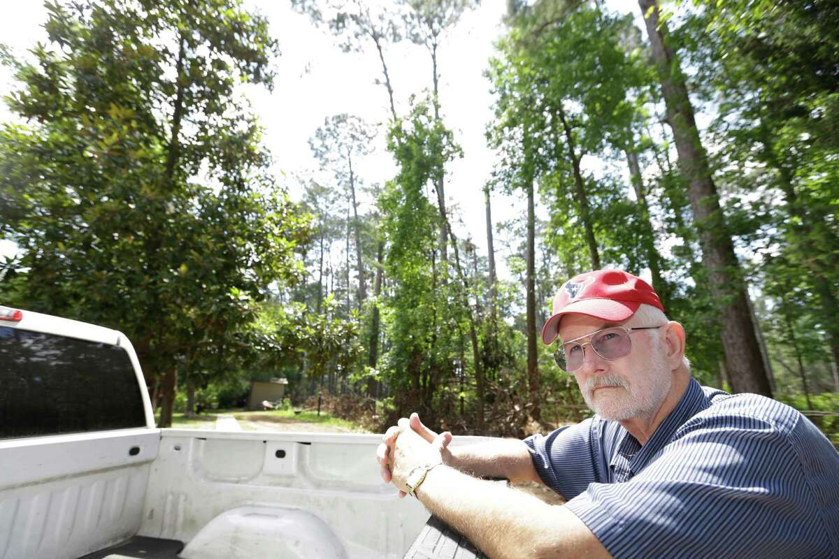 """Warren Oja, a Sam Houston National Forest District ranger, is looking at urban growth, including expansion of Interstate 45, with a worried eye. """"There are now six lanes to our doorstep,"""" he says."""